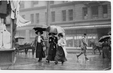 Photo of Women in Rain Downtown
