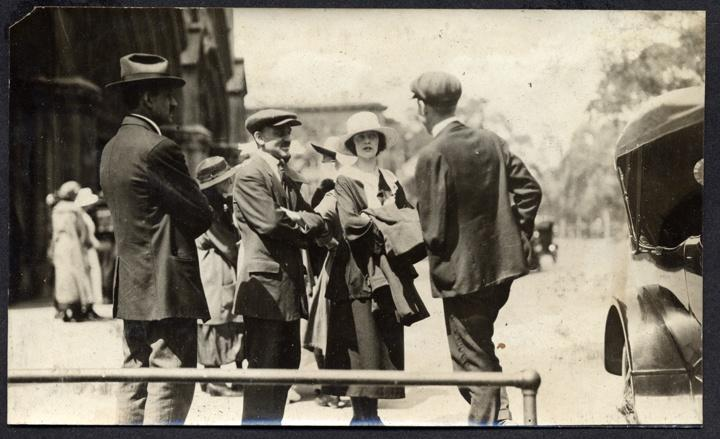 Photo of Four People in the 1920s with Automobile