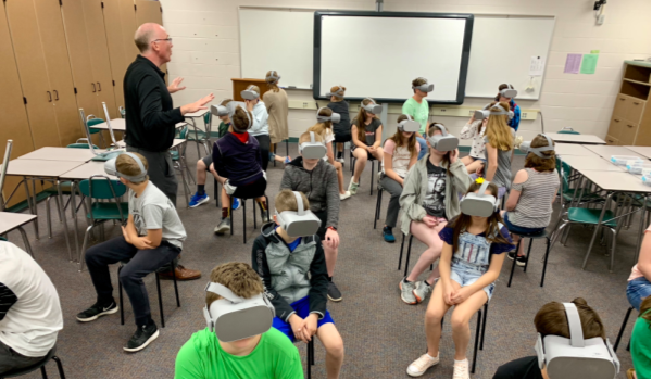 Ted Green instructing students on how to us the Eva Virtual Reality Tour on Oculus Go headsets.