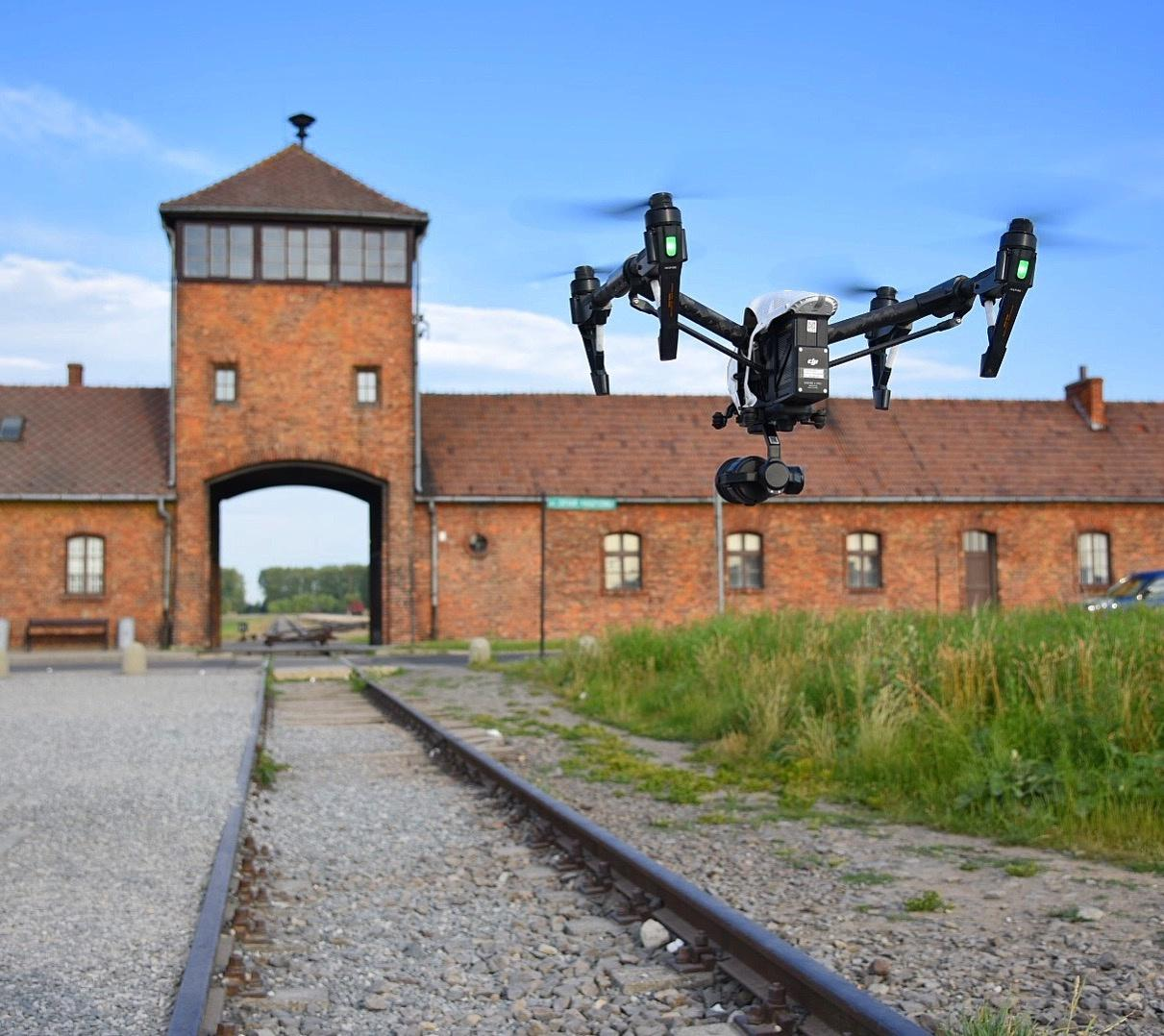 A shot of a drone filming the Eva Kor documentary at Auschwitz.