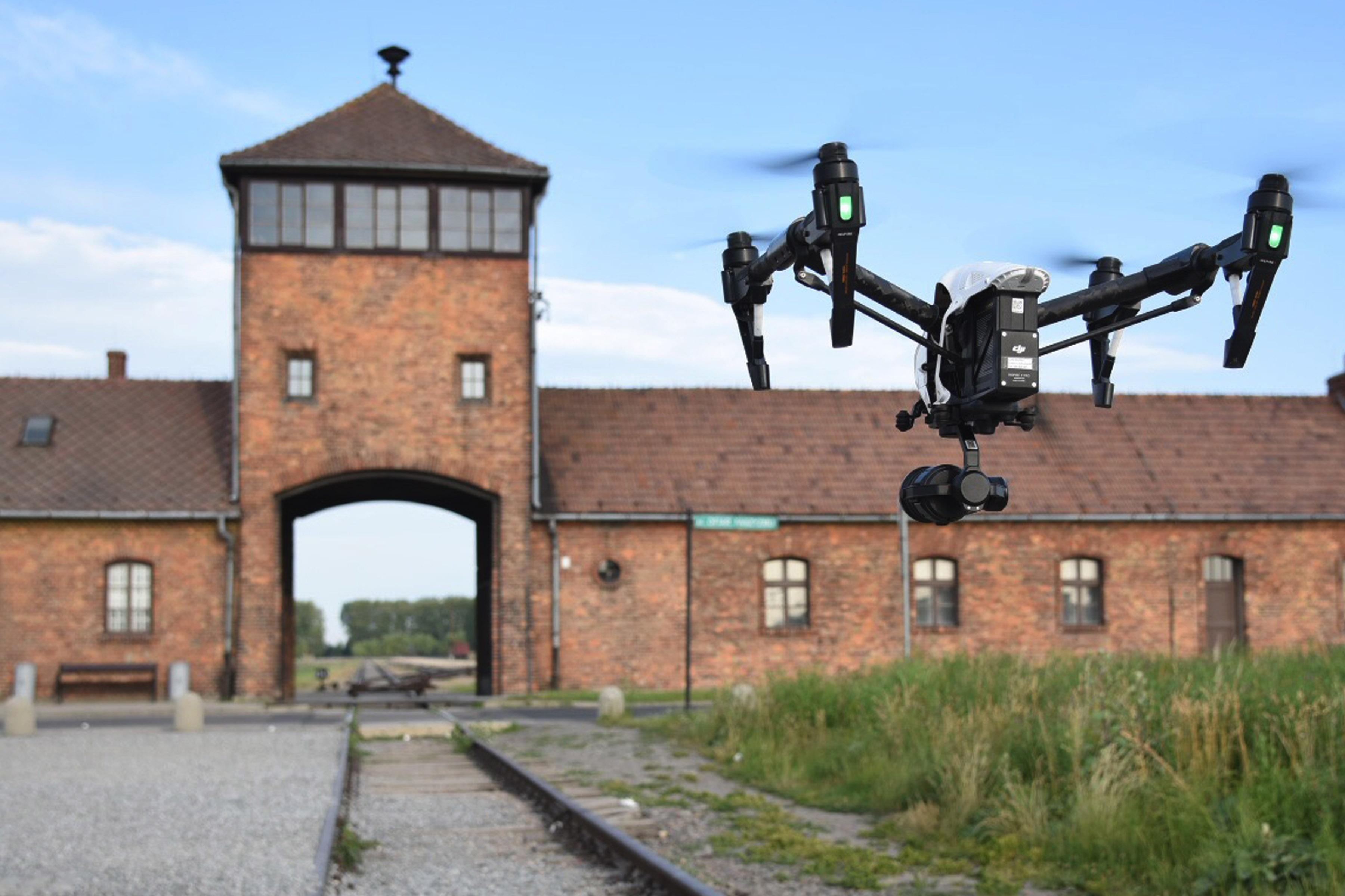 Drone flying towards the entrance of Auschwitz.