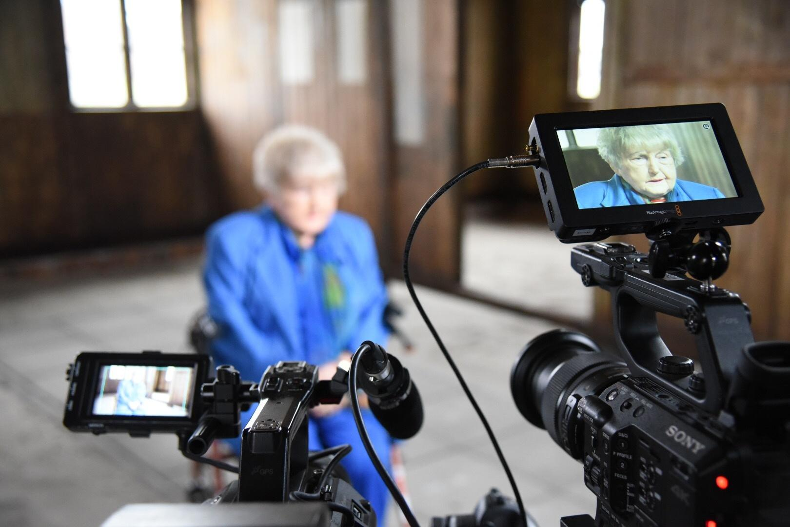 Eva Kor being interviewed at Auschwitz in the 'blood labs.'