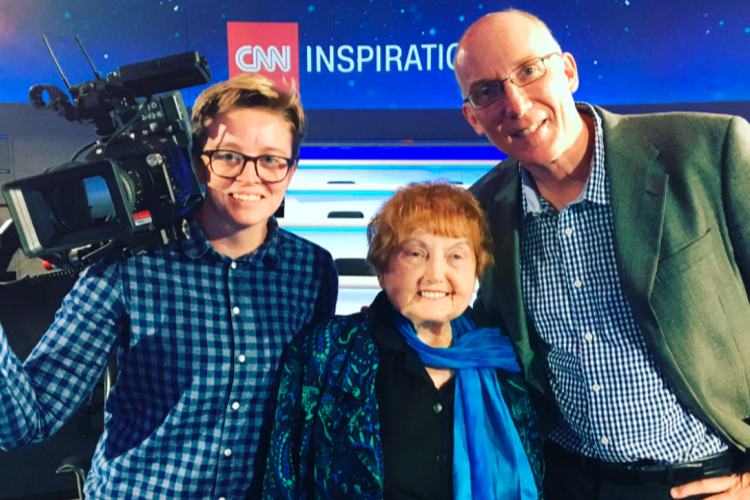 Co-Producers Ted Green and Mika Brown stand with Eva Kor at the CNN studios in London.