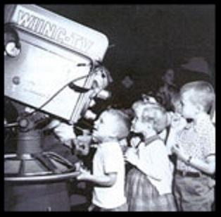 Vintage photo of kids at WUNC camera