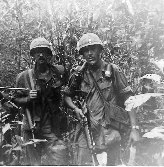 Black and white photo from Quentin Schillare or two soldiers in the jungle