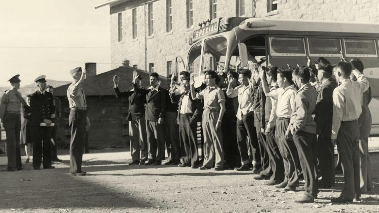 Twenty-nine Navajo recruits, about to be trained as code talkers, arrive at Fort Wingate in April 1942.