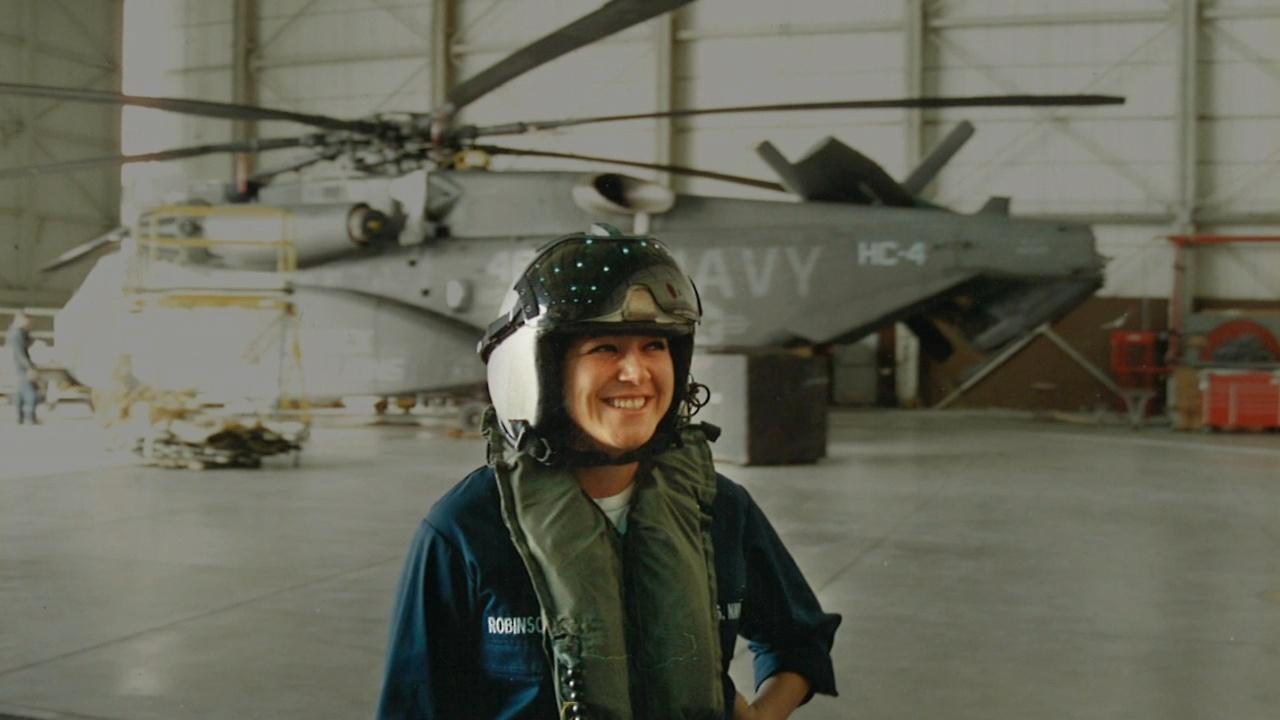 Elizabeth Perez in front of Navy helicopter