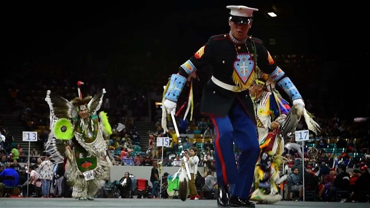 symbol of a warrior, Marine dancing at a powwow