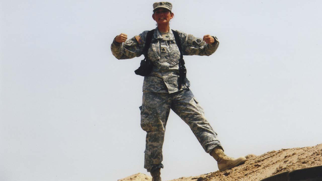 warrior woman in military uniform