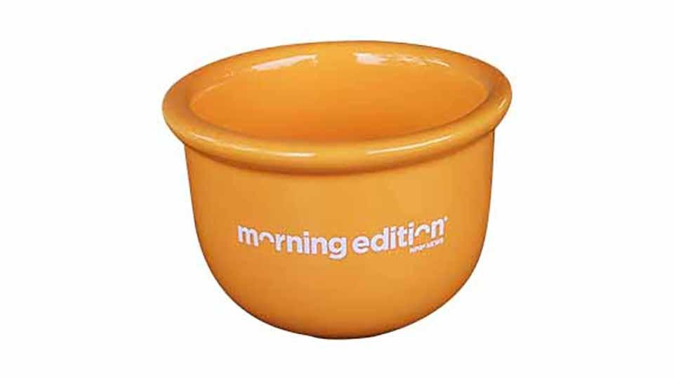 Orange cereal bowl with Morning Edition logo