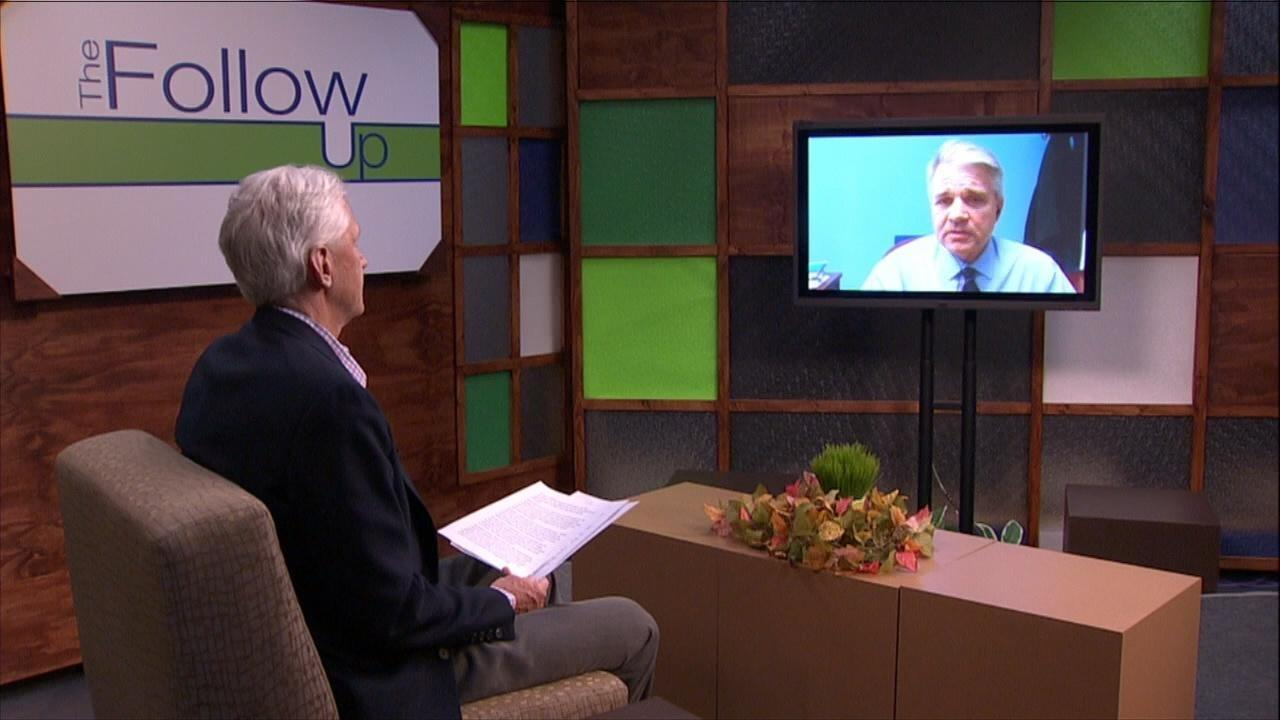 Host Mike Redford on The Follow Up set talks to Joel Strasz on a monitor.