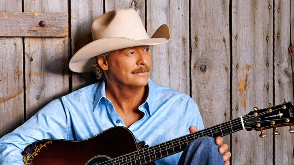 Alan Jackson on his back porch with an acoustic guitar