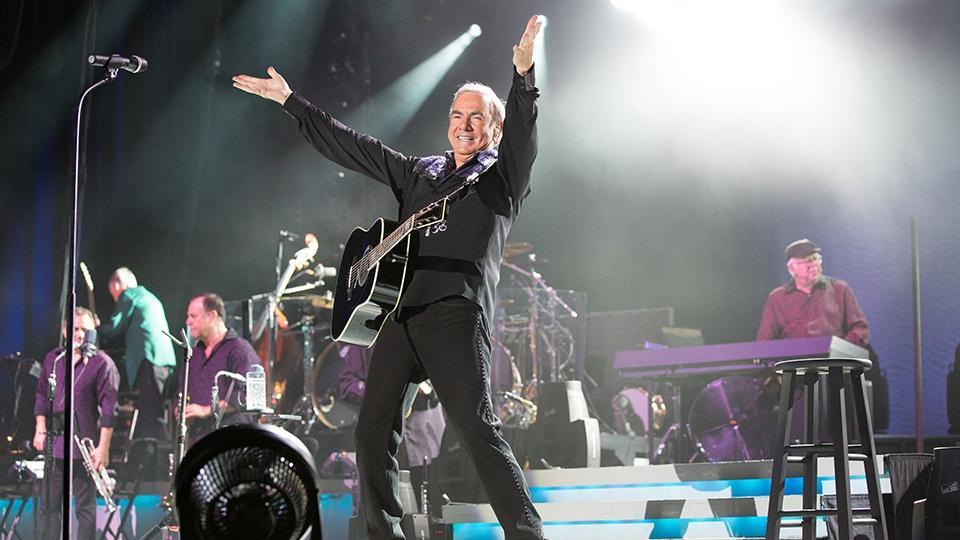 Neil Diamond on stage.