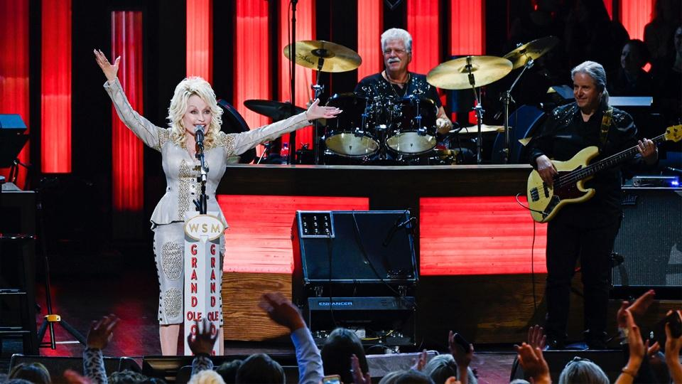 Dolly Parton and her band onstage.