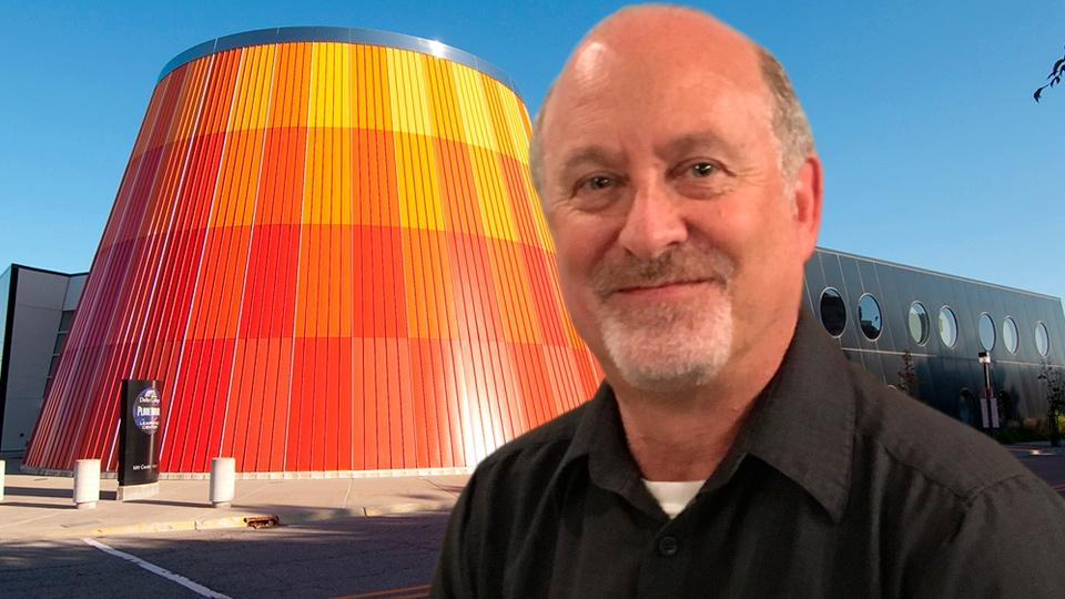 Mike Murray stands in front of the Delta College Planetarium.