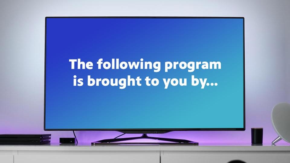"""A TV with a graphic on the screen that says, """"The following program is brought to you by..."""""""
