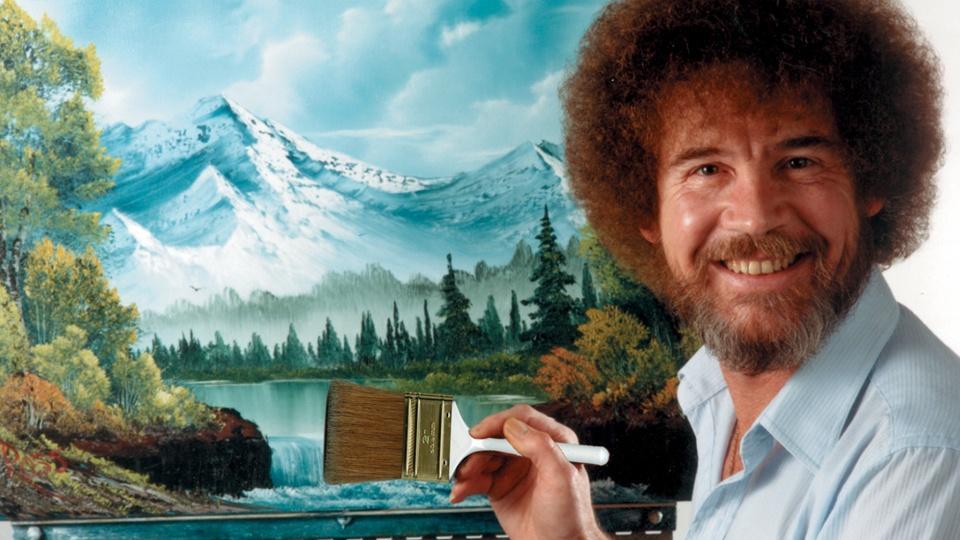 Bob Ross painting a mountain landscape.