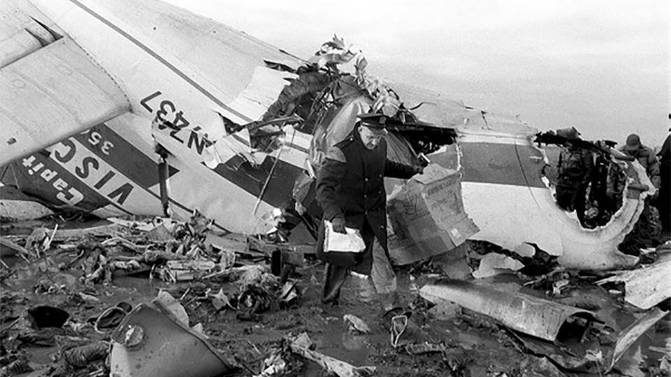 A police officer investigates the wreckage of Capital Airlines flight 67.