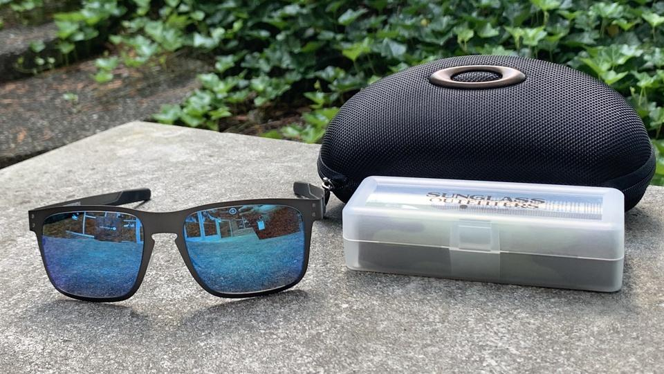 Oakley Holbrook Sunglasses, carrying case, and cleaning kit.