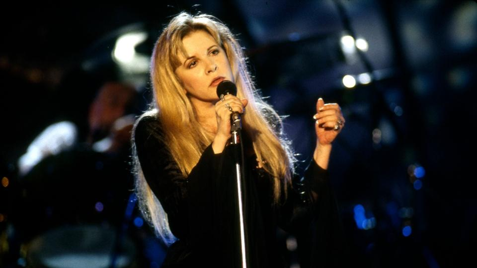 Stevie Nicks performing onstage with Fleetwood Mac.