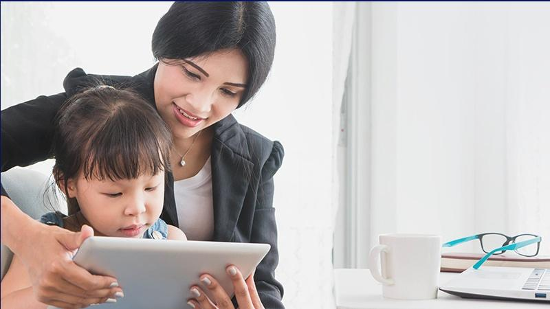 Photo of mom and daughter using tablet