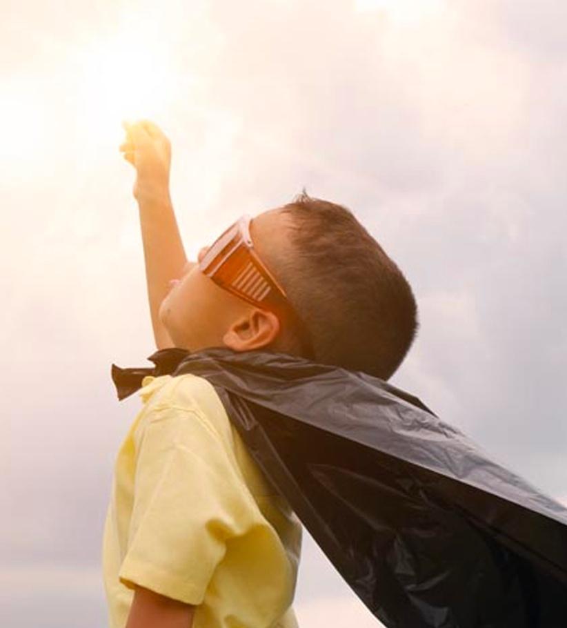 Child dressed as super hero