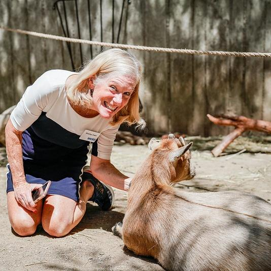 Shelley Irwin with a goat at the petting Zoo