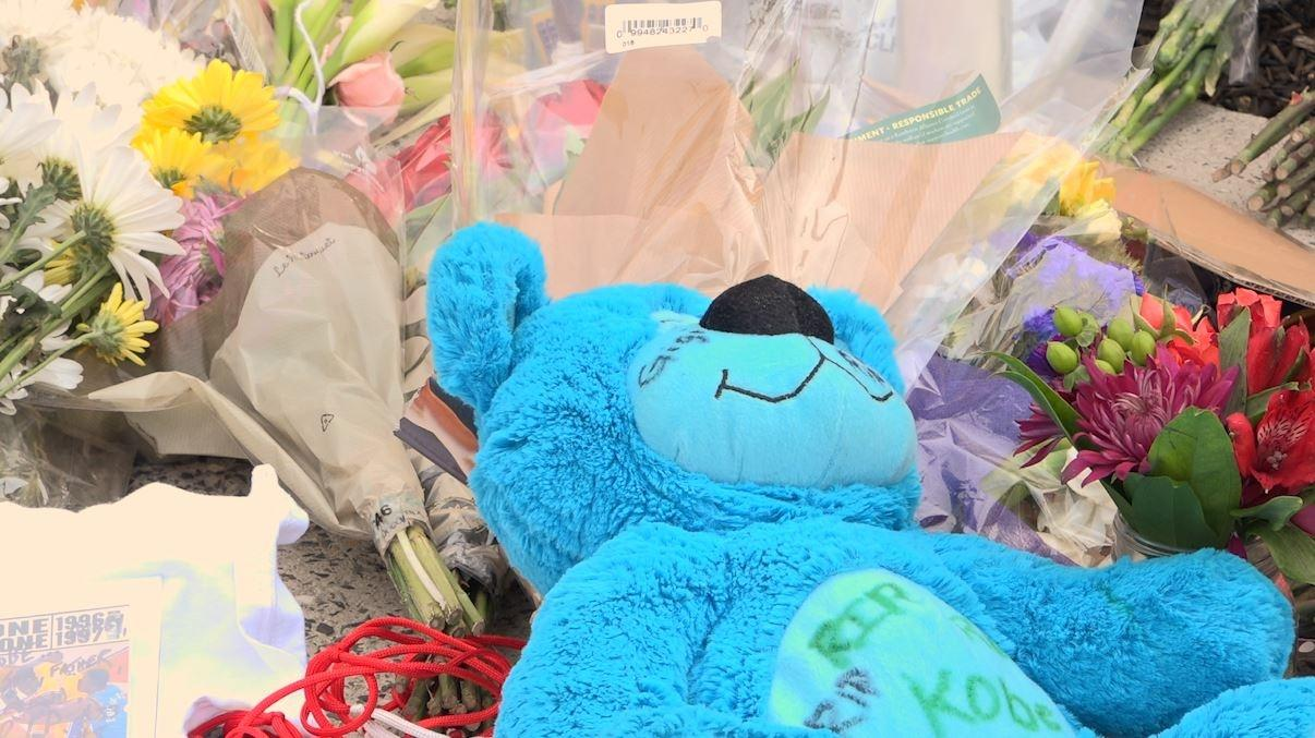 Michael Briggs of South Philadelphia left a teddy bear at the memorial at Lower Merion High School.