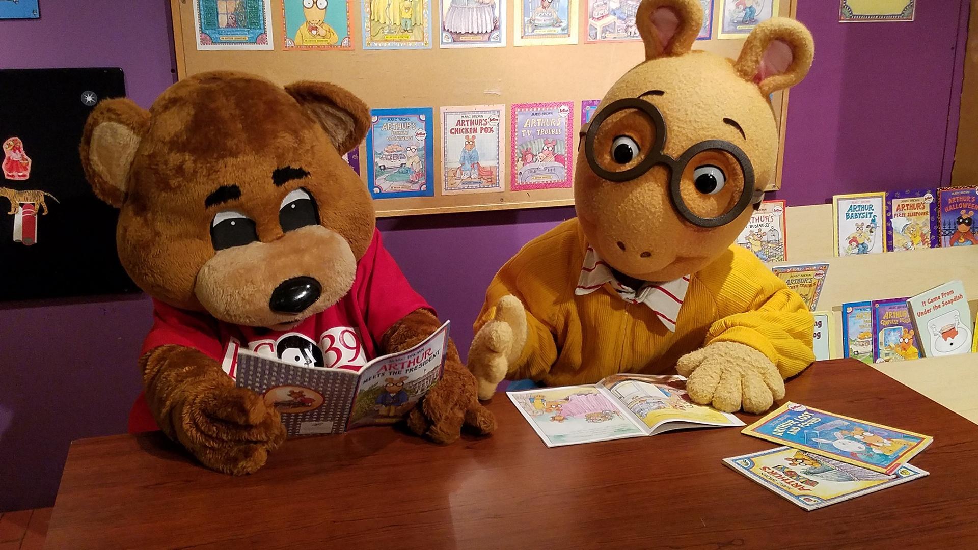 TeleBear and Arthur read a book together