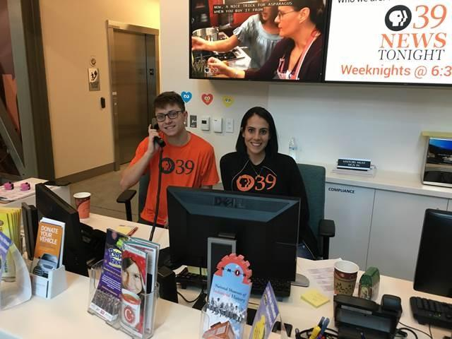 Team members at the desk during an event