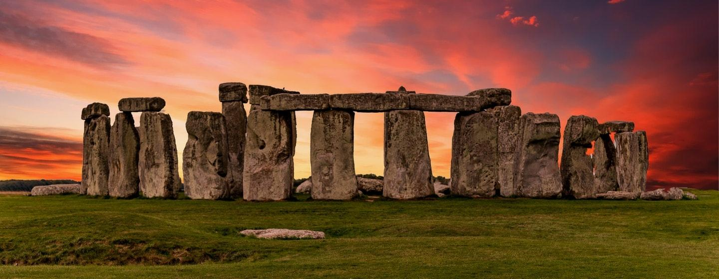 Stonehenge with a colorful sky in the background