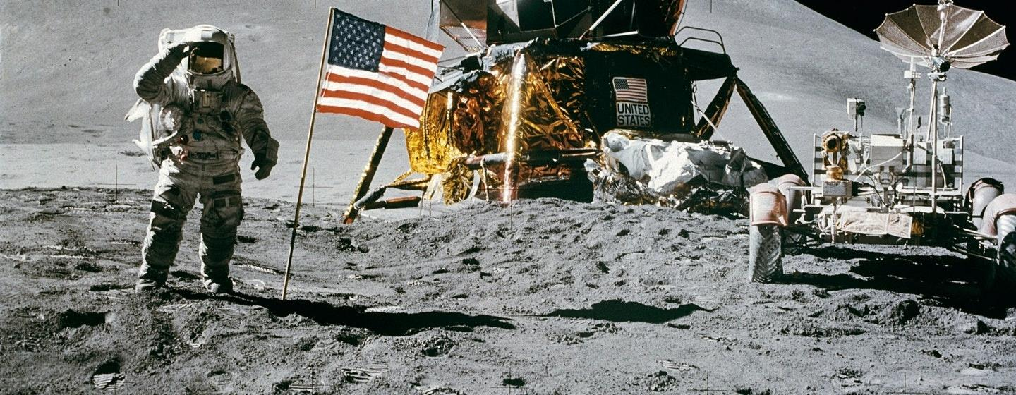 Man on the moon with an American flag and Rover