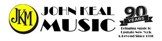 John Keal Music Logo with a yellow circle sympol with the letters JKM in black and John Keal Music stacked in black to the right of the circle. Also featuring a logo element that says '90 years. Bringing Music to Upstate New York & Beyond Since 1930.'