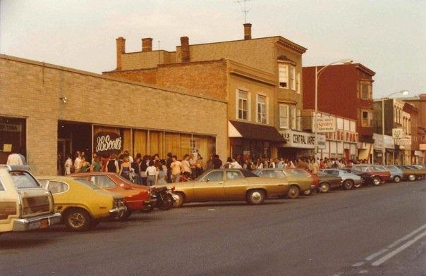 J.B. Scott's on Central Avenue with 1970s era cars parked outside and a crowd gathered in front.