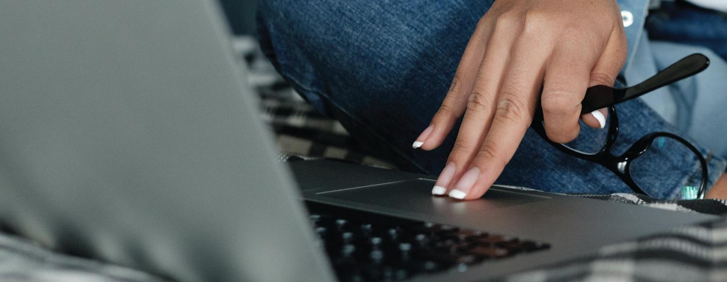 An individual is shown using a laptop to browse the internet.