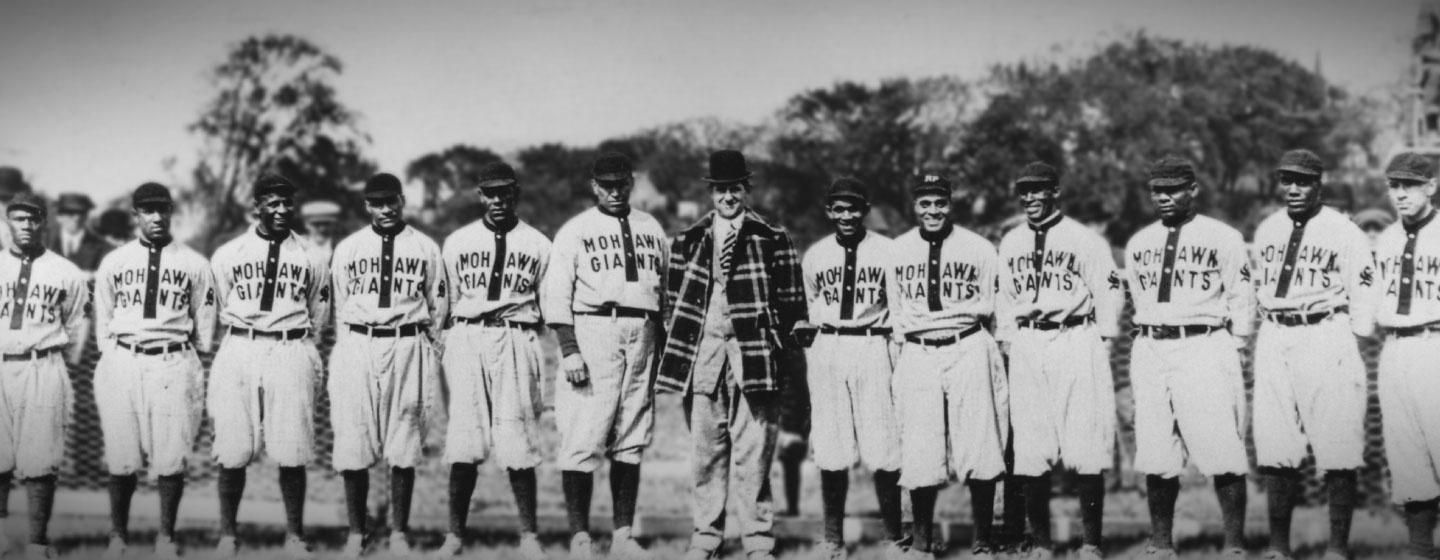 The Mohawk Giant Negro League Baseball team standing in a lineup, posing for a photo