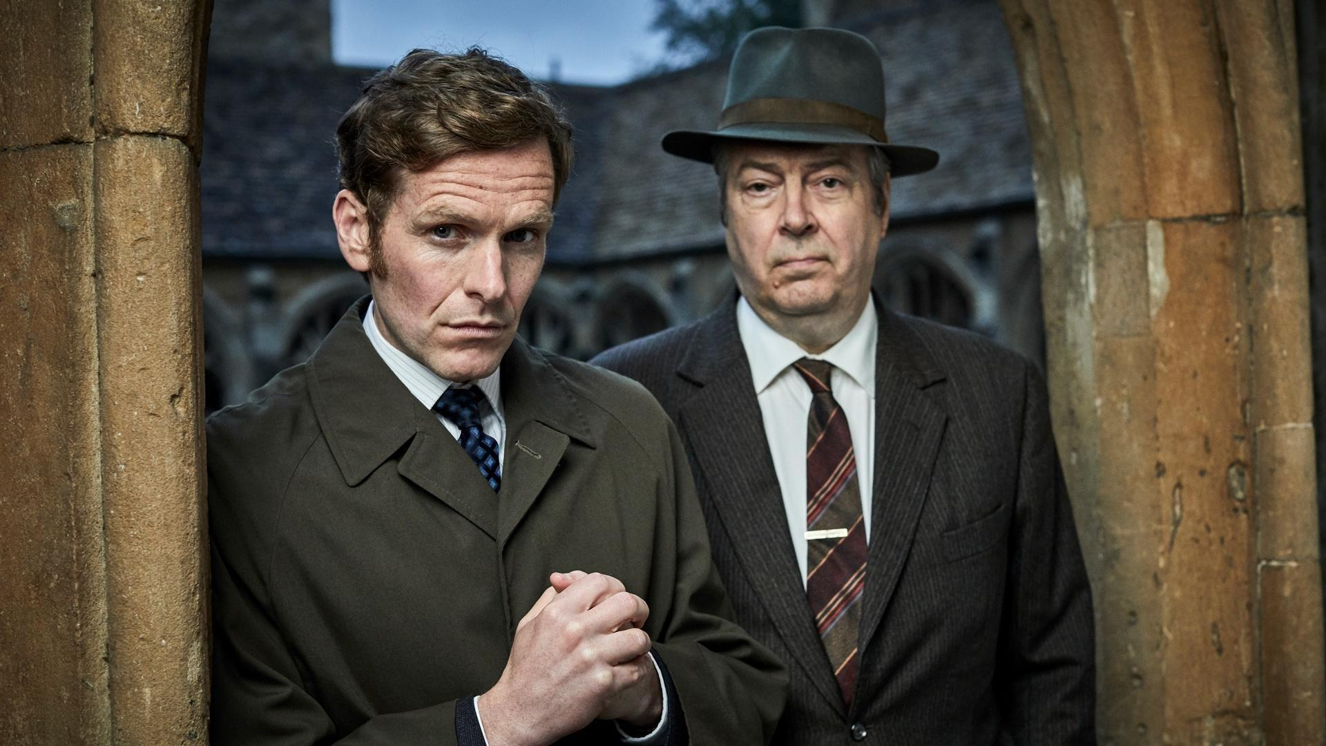 Detective Sergeant Endeavour Morse and Inspector Fred Thursday pose in a church archway.