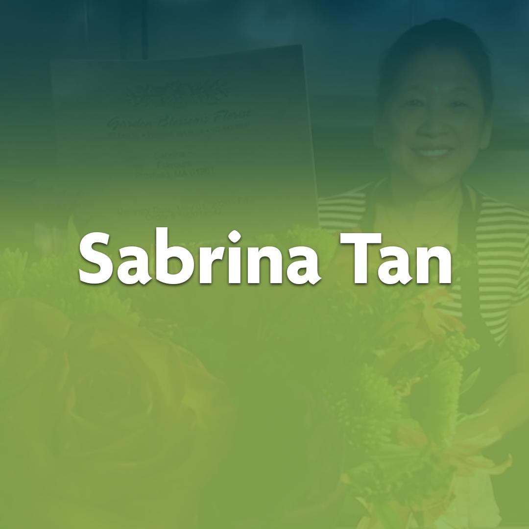 Extraordinary Neighbor Sabrina Tan is seen posing with flowers.