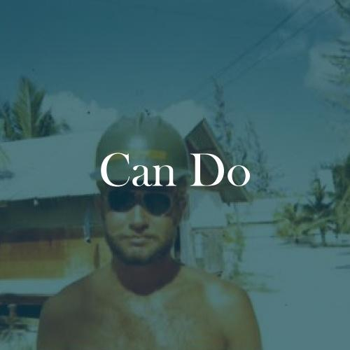 "The word ""Can Do"" is displayed in white, serif, type on a dark green transparent overlay over an image of will wearing a green hard hat."