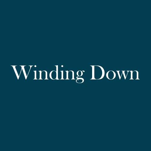 "The word ""Winding Down"" is displayed in white, serif, type on a dark green background."