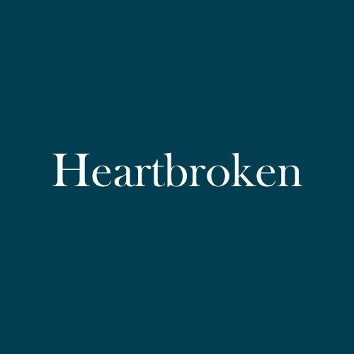 "The word ""heartbroken"" is displayed in white, serif, type on a dark green background."