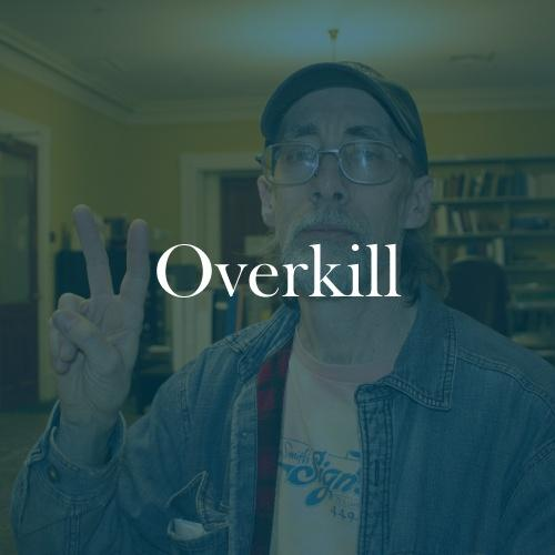 "The word ""overkill"" is displayed in white, serif, type on an image of Frank from Albany doing a peace hand gesture.."