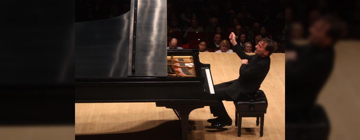 Pianist Stephen Hough playing at a concert.
