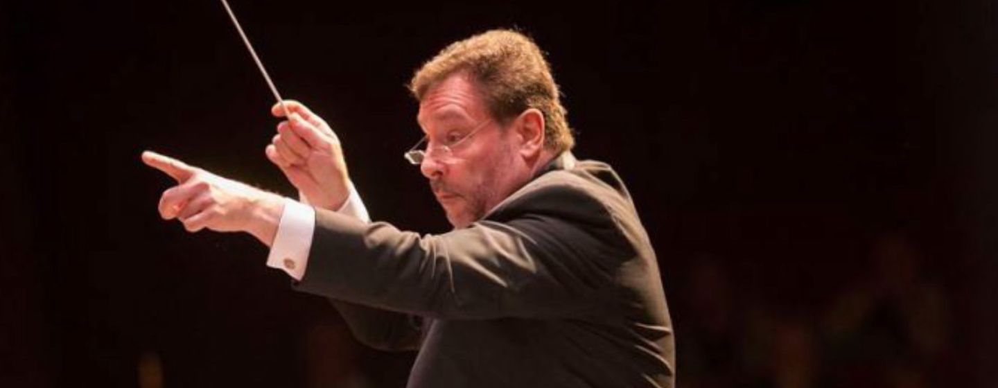 Schenectady Symphony Artistic Director Glen Cortese conducting an orchestra