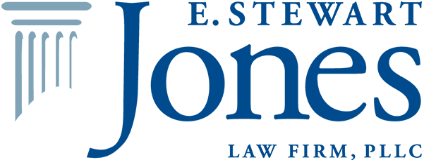 E. Stewart Jones LLP Logo in blue, serif font with a light blue column illustration to the left