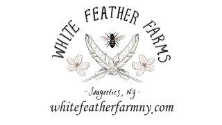 White Feather Farms Logo with illustration of two feathers crossing over one another with a bumble bee and two flowers