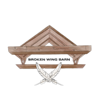 Broken Wing Barn Logo with the words Broken Wind Barn in black under a roof illustration and two white feathers crossed over one another