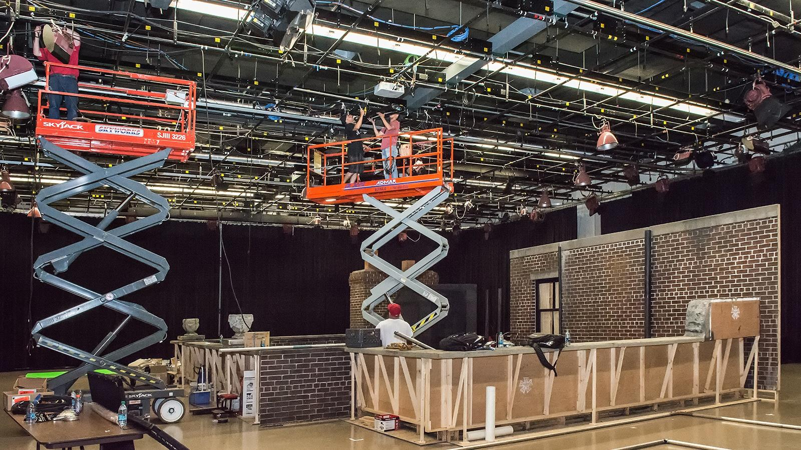 crew hanging lights in Studio One