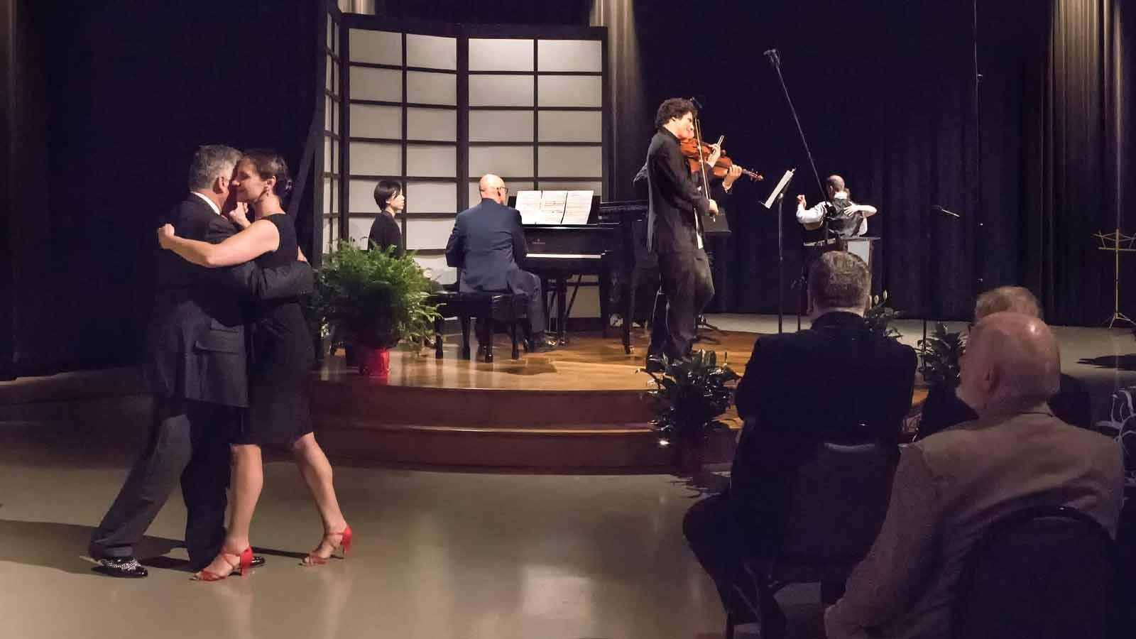 Tango dancers and violinists