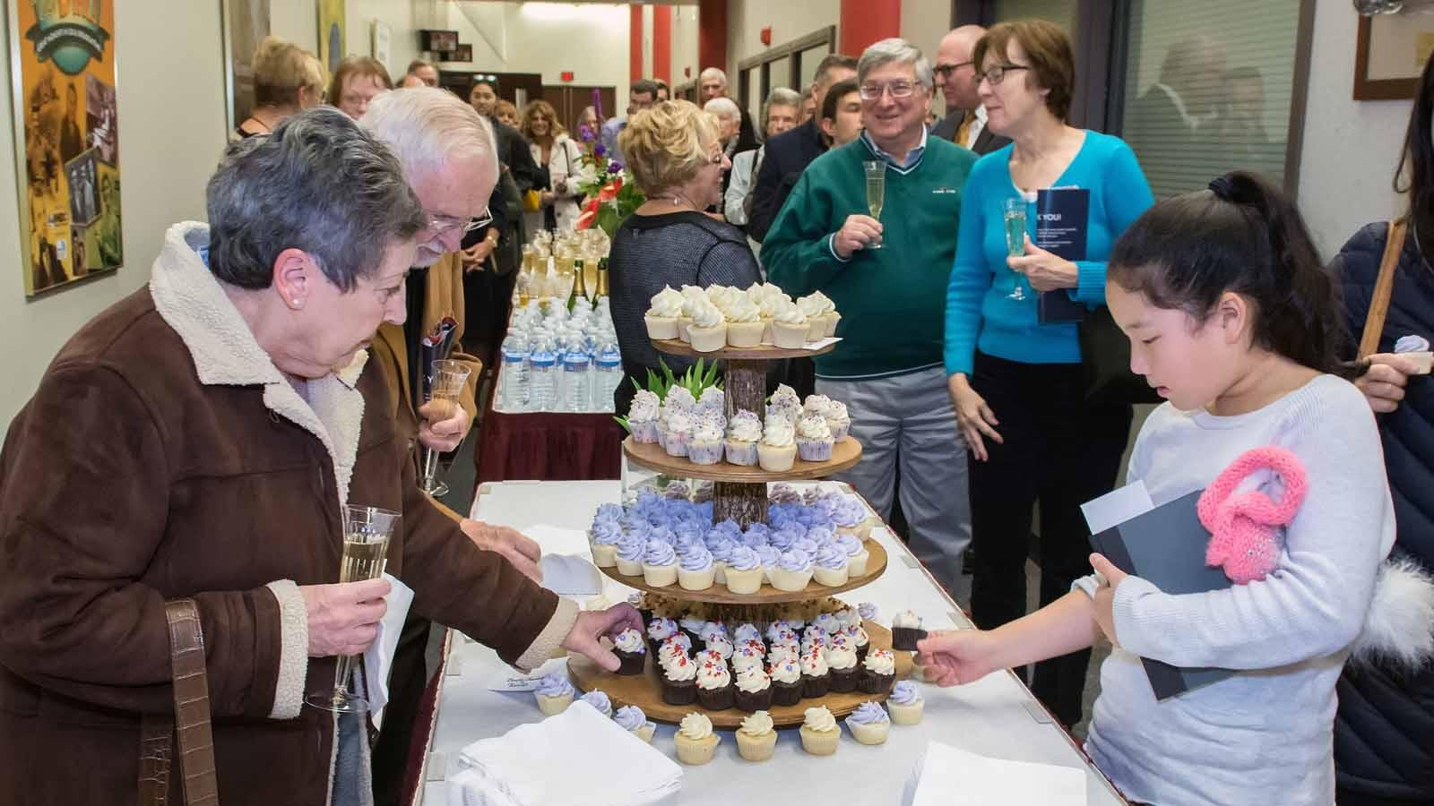 Guests celebrated with champagne and cupcakes.